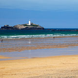 Lighthouse - Gwithian, Cornwall, Uk. Beach, Sea, Tourists - Godrevy Lighthouse in Cornwall, UK royalty free stock image