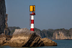 Lighthouse, Ha Long Bay, Vietnam. Lighthouse on the rock at Ha long Bay in North Vietnam Stock Photos
