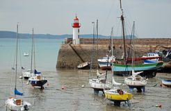 Lighthouse harbor and boats stock photography