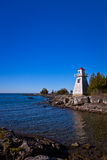 Lighthouse at a harbor in Canada Royalty Free Stock Photo