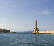 Lighthouse in the harbor of Chania Stock Photos