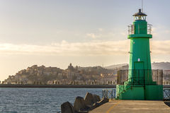 Lighthouse at the harbor entrance Stock Photography