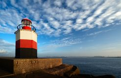 Lighthouse with harbor view Stock Photos