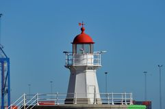 Lighthouse in the harbor. White, red lighthouse in the harbor in the Sweden, Malmo Stock Image