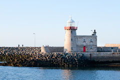 Lighthouse and harbour in Howth Stock Image