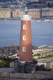 Lighthouse at harbour in Naples Italy Stock Photo
