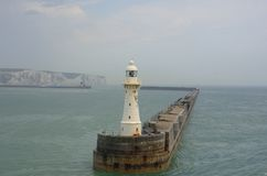 Lighthouse on harbour wall Royalty Free Stock Image