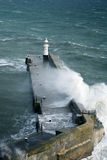 Harbour Wall, Mevagissey. Lighthouse on harbour wall in Mevagissey, Cornwall, UK Royalty Free Stock Photography