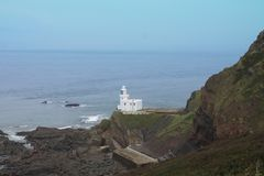 The lighthouse at Hartland Point stock image