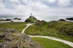 Lighthouse on hill stock photos