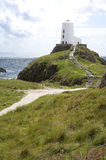 Lighthouse on hill overlooking Irish Sea. Stock Image