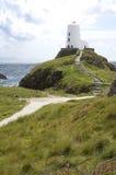 Lighthouse on hill overlooking Irish Sea. stock image