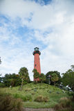 Lighthouse on hill Stock Photo