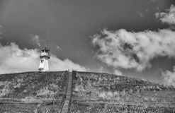 Lighthouse on a hilltop Stock Photo