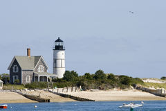 Lighthouse and home at Cape Cod. Wooden house and white lighthouse at Cape Cod near Portland Stock Photography