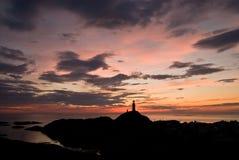 Lighthouse on the horizon Stock Photos