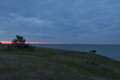 Lighthouse at horizon Royalty Free Stock Image