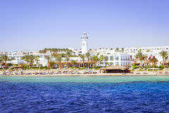 Lighthouse and hotel on the beach, Sinai, Red sea, Sharm El Sheikh, Egypt Royalty Free Stock Photo