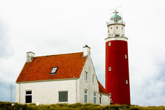 Lighthouse with house Stock Photo
