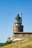 Lighthouse. A lighthouse with house on a rock in Sweden Stock Photos