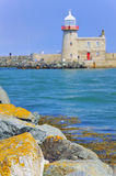 Lighthouse at howth harbor Stock Images