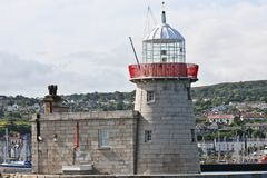 Lighthouse at Howth harbor in Ireland. Lighthouse at Howth harbor, north of Dublin, Eire Stock Photo
