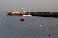 Lighthouse at Howth port. Howth is a fishing small port near Dublin Bay. stock photography