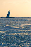 Lighthouse in the ice. The Horse of Marken of Marken is the lighthouse. The lighthouse was designed by J. Valk and built in 1839 and stands on the eastern tip of Stock Image