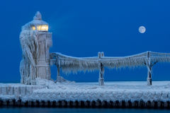 Lighthouse Ice Sculpture at Night. Ice accumulates on the St. Joseph North Pier Lighthouse in Saint Joseph, Michigan Royalty Free Stock Image