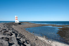 Lighthouse in Iceland. Lighthouse on the sea on the Reykjanes peninsula in Reykjavik, Iceland Royalty Free Stock Photography