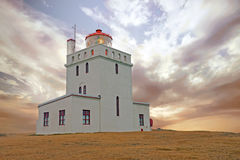 Lighthouse on Iceland at sunset Stock Photos