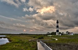 Lighthouse and incoming stormclouds Royalty Free Stock Image