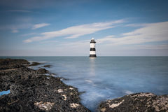 Lighthouse. An incoming tide shot, taken on the rocks near Brougham Lighthouse Stock Photo