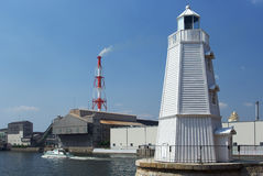 Lighthouse in an industrial zone. This lighthouse is one of the oldest wooden lighthouses in Japan. It was built in the port in Osaka Prefecture Sakai City in Stock Photography