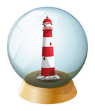 A lighthouse inside the crystal ball Stock Image