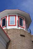 Lighthouse inspired architecture of small Midweste. Architecture of Mackinaw City in Michigan with a buliding designed to look like a lighthouse Royalty Free Stock Photography