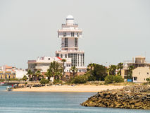 The lighthouse Isla Cristina, Spain. The lighthouse, at Isla Cristina and the beach Playa el Cantil, as seen from Punta del Moral, near Ayamonte, Huelva Province Stock Image