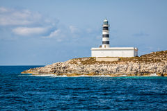 Lighthouse on Isla de Es Penjats near Ibiza, Balearic Islands, S Royalty Free Stock Photography