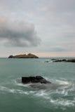 Lighthouse on island Stock Photos