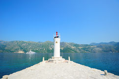 Lighthouse on the island Stock Images