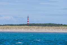 Lighthouse on island of Ameland with blue sky Royalty Free Stock Image