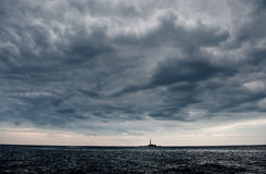 Lighthouse island in cloudy weather. Stock Photography