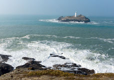 Lighthouse and island Cornwall coast England UK Stock Photography