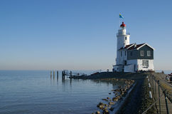 """Lighthouse on the island Marken, the Netherlands. The old lighthouse of Marken, named  """"the Horse of Marken""""  is still there as a landmark and a memory of Royalty Free Stock Photo"""