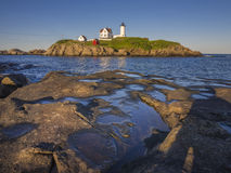 Lighthouse island off the coast of Maine Stock Images