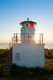 Lighthouse on the island Oland, Sweden. The lighthouse on the island of Oland Byxelkrok, Sweden, in light of the setting sun, back light situation royalty free stock images