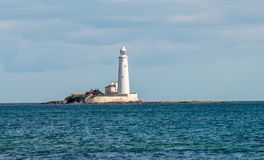 A lighthouse on an island in Whitley Bay near Newcastle upon Tyne, England. Great Britain Stock Photography