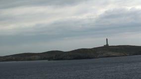 Lighthouse on an island stock video