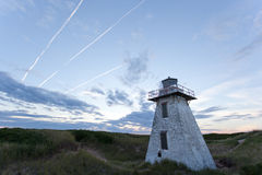 Lighthouse with Jet Trails Royalty Free Stock Photo