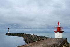 Lighthouse at the jetty Royalty Free Stock Images
